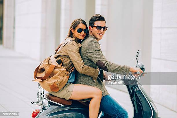 Young couple on motor scooter