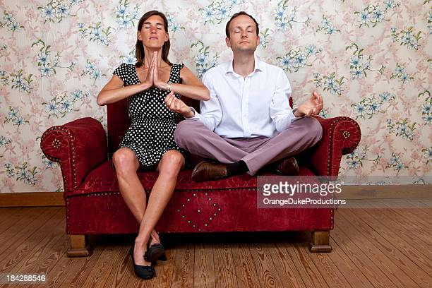 young couple on old school couch - freaky couples stock photos and pictures