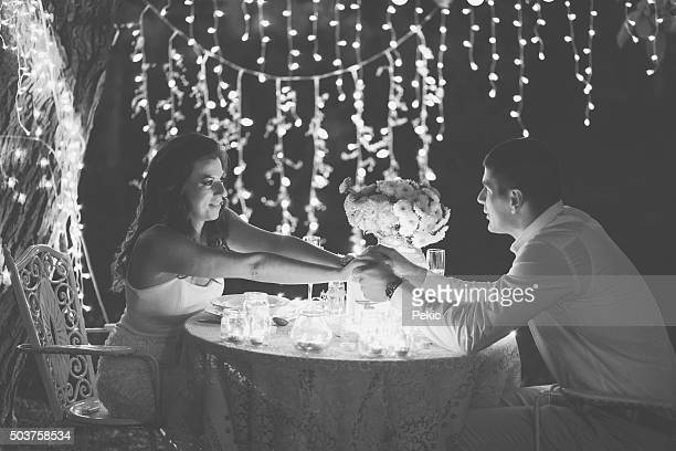 Young couple on romantic dinner with candles