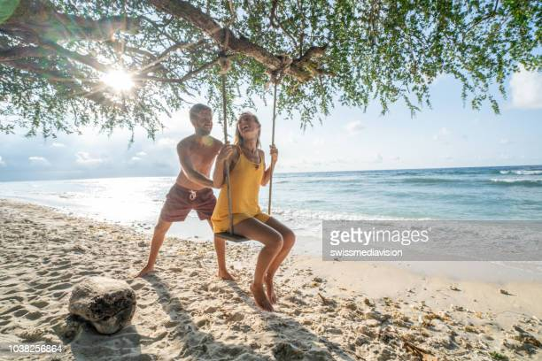young couple on sea swing, bali, indonesia - honeymoon stock pictures, royalty-free photos & images