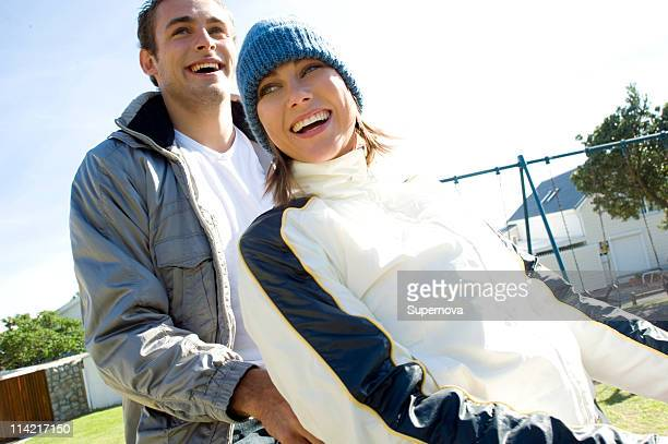 Young couple on see-saw, Bakoven, Cape Town, Western Cape Province, South Africa
