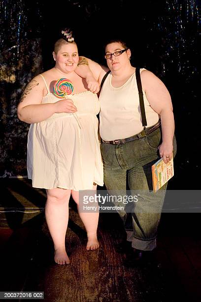 young couple on stage with lollipop and storybook, portrait - short hair for fat women stock pictures, royalty-free photos & images