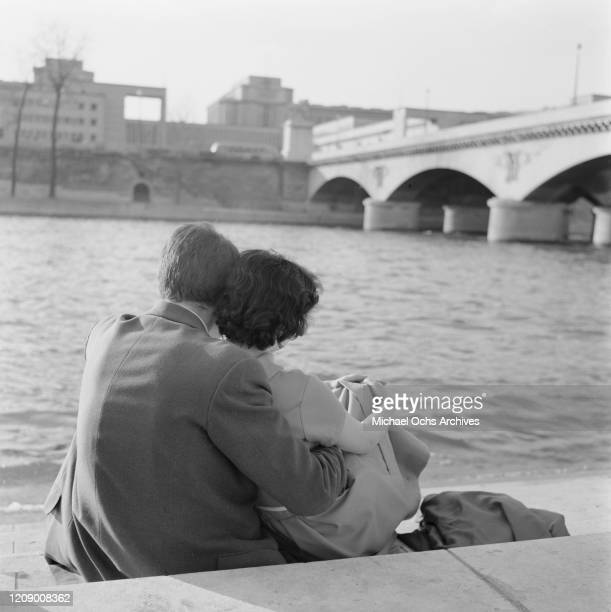 A young couple on the banks of the River Seine in Paris France in the spring April 1958