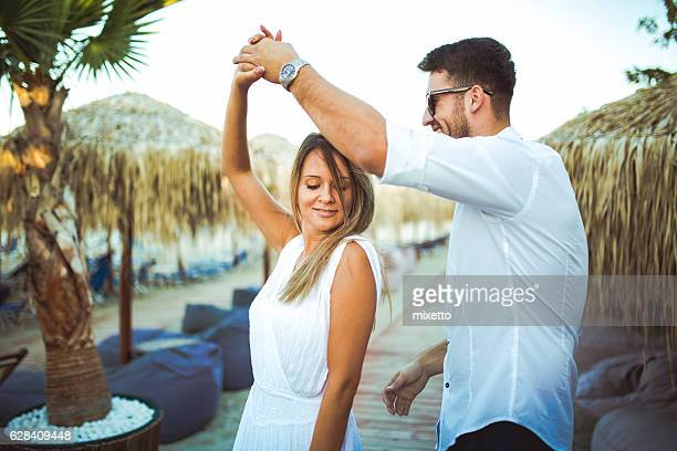 Young couple on the beach party