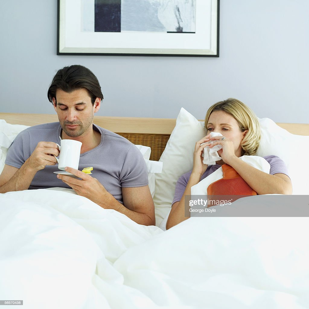 young couple on the bed : Stock Photo