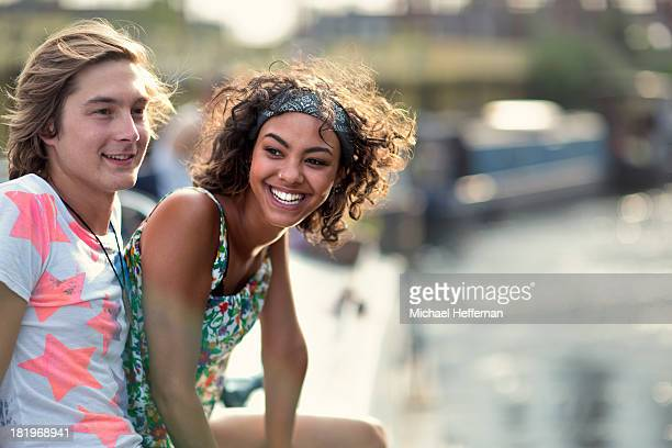 young couple on top of a canal boat