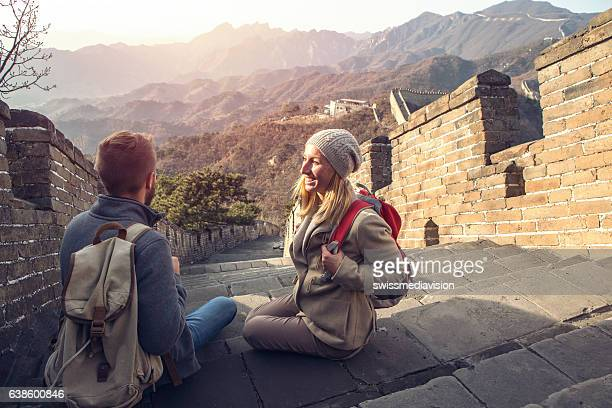 young couple on top of the great wall of china - beijing province stock photos and pictures