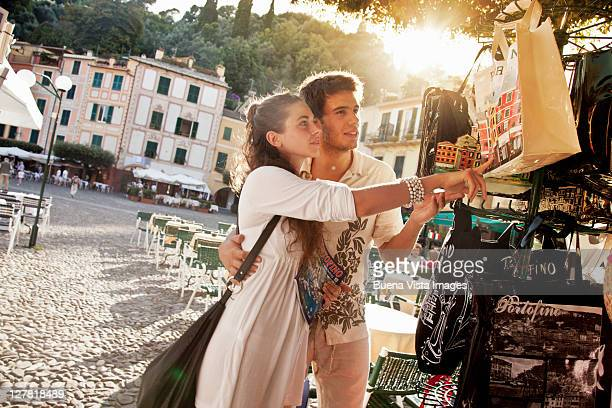 young couple on vacation in portofino - ricordi foto e immagini stock