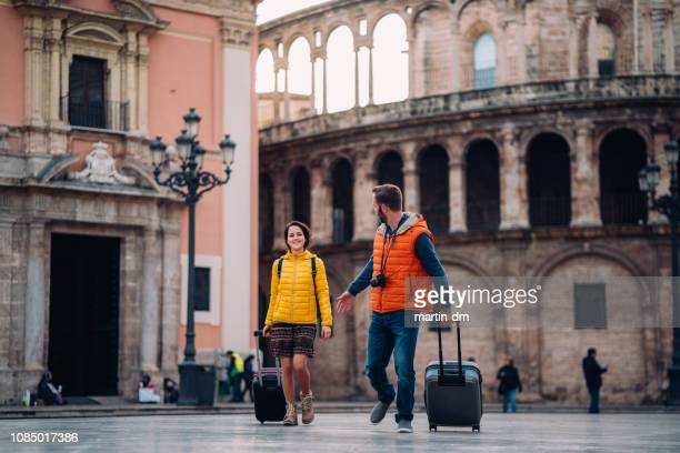 young couple on vacation traveling around europe - valencia spagna foto e immagini stock
