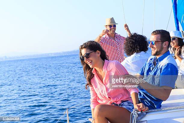 Young couple on vacation with friends-copy space