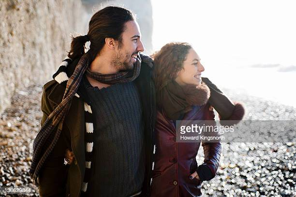 young couple on windswept beach