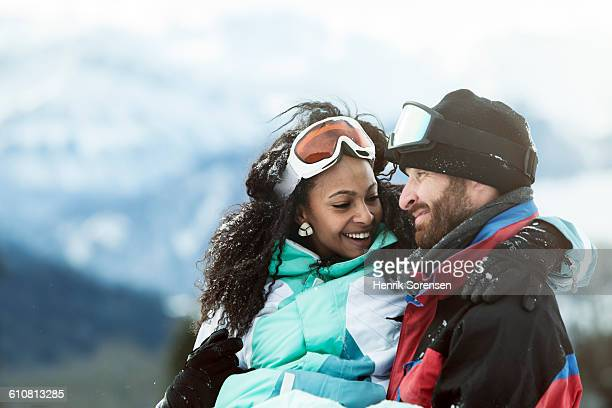young couple on winter holiday - ski holiday stock pictures, royalty-free photos & images