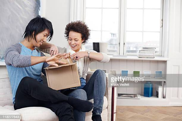 Young couple opening package
