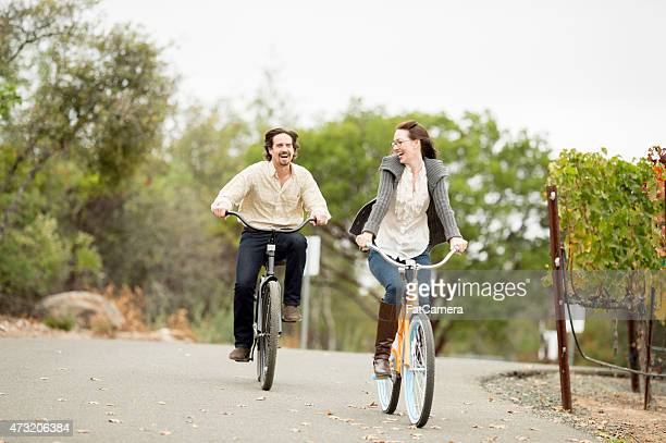young couple out for a bike ride - napa valley stock pictures, royalty-free photos & images