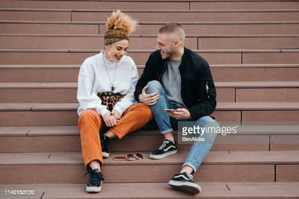 young couple outdoors - generation z stock pictures, royalty-free photos & images