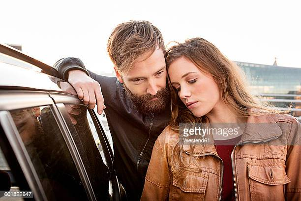 Young couple outside car