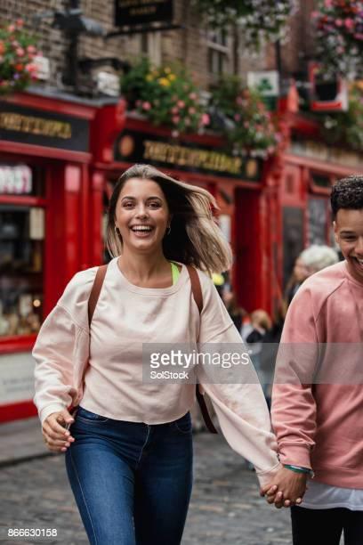 Young couple outside public house Dublin