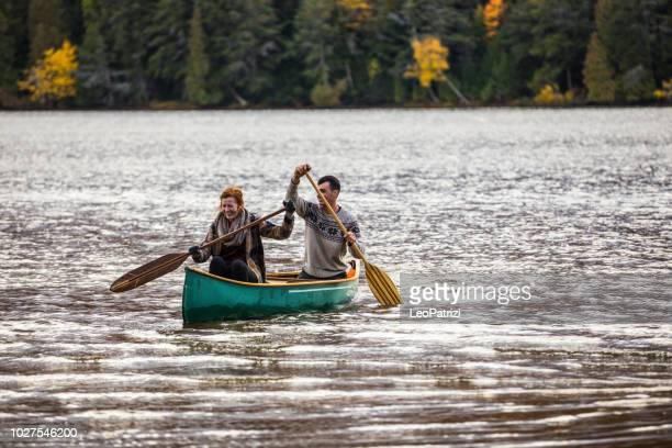 young couple paddling in the wonder of nature in canada - canadian culture stock pictures, royalty-free photos & images