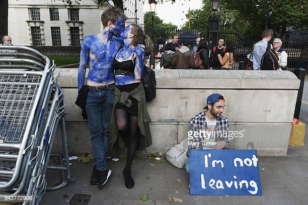 A young couple painted as EU flags protest on outside Downing Street against the United Kingdom's decision to leave the EU following the referendum...