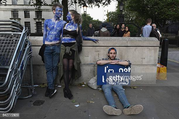 Young couple painted as EU flags protest on outside Downing Street against the United Kingdom's decision to leave the EU following the referendum on...