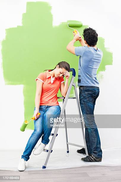 Young couple painting together.