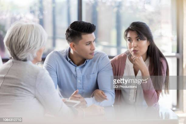 young couple participate in marriage counseling - human fertility stock pictures, royalty-free photos & images