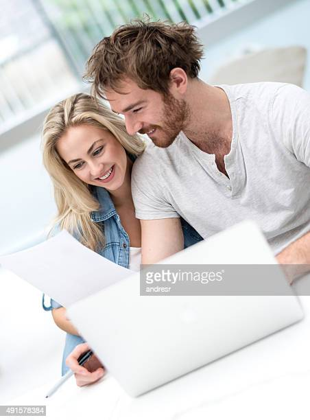 Young couple paying bills online