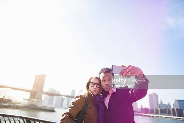 Young couple photographing themselves, New York, USA