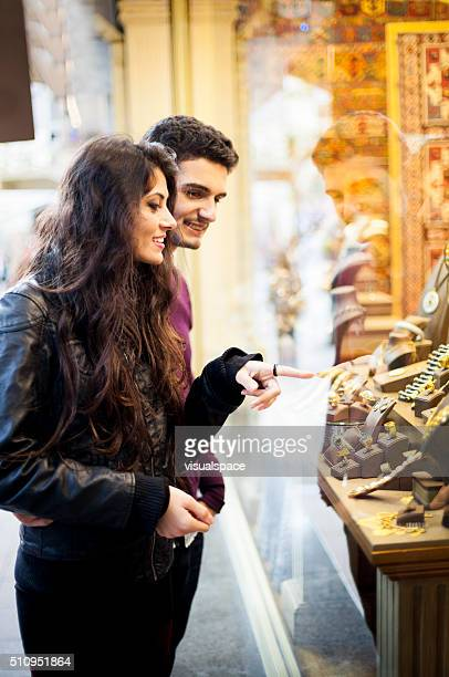 Young Couple Picking Jewelry to Buy