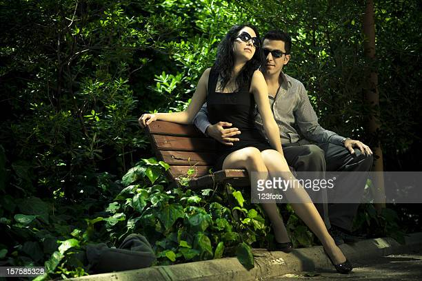 young couple - legs and short skirt sitting down stock photos and pictures