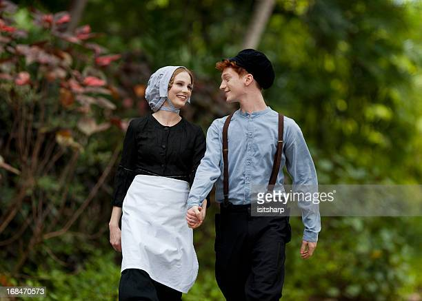 young couple - amish woman stock pictures, royalty-free photos & images