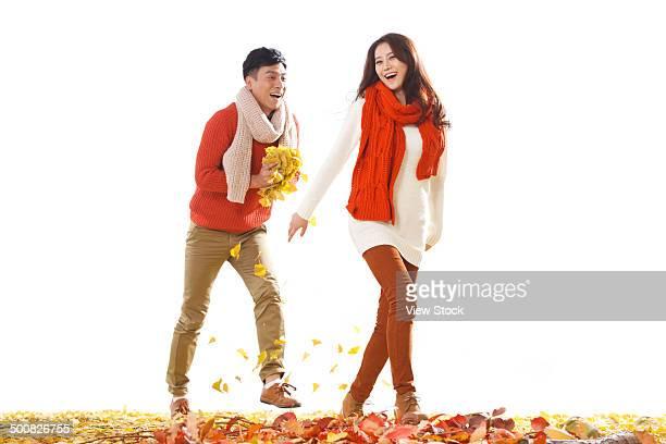 young couple - 追いかける ストックフォトと画像