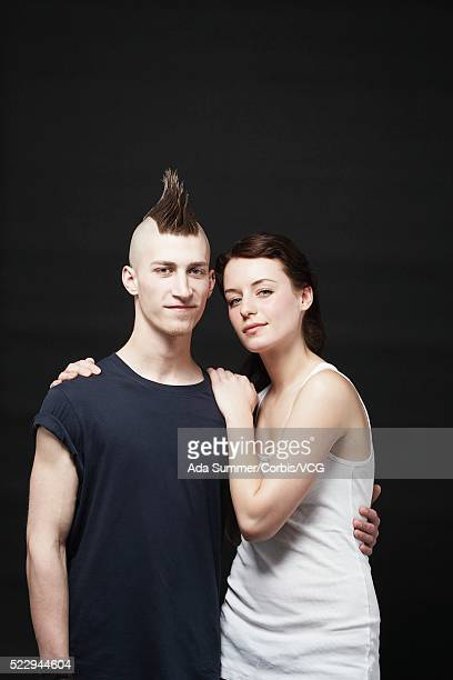 young couple - パンクロック ストックフォトと画像