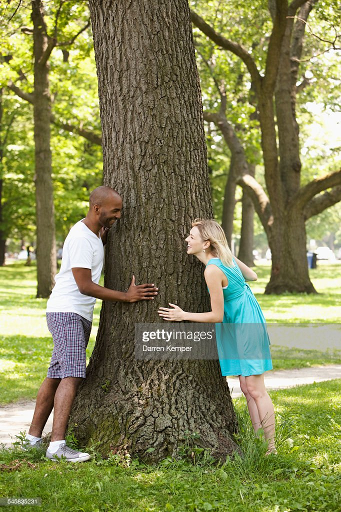 Young couple playing around in a park : Foto de stock