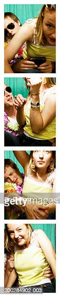 Young couple playing around in photo booth