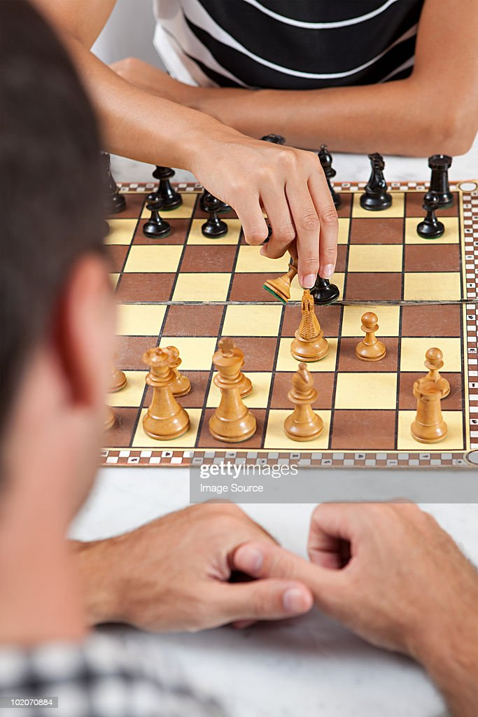 Young couple playing chess : Stock Photo