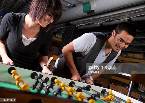 Young Couple Playing Foosball
