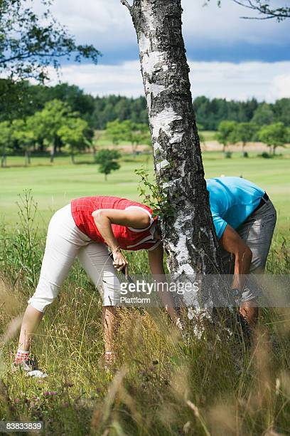 A young couple playing golf Sweden.