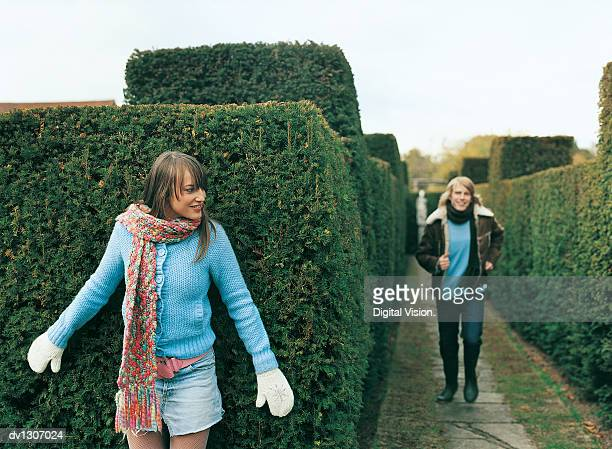 Young Couple Playing Hide and Seek in a Maze