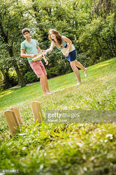 Young couple playing Molkky in park