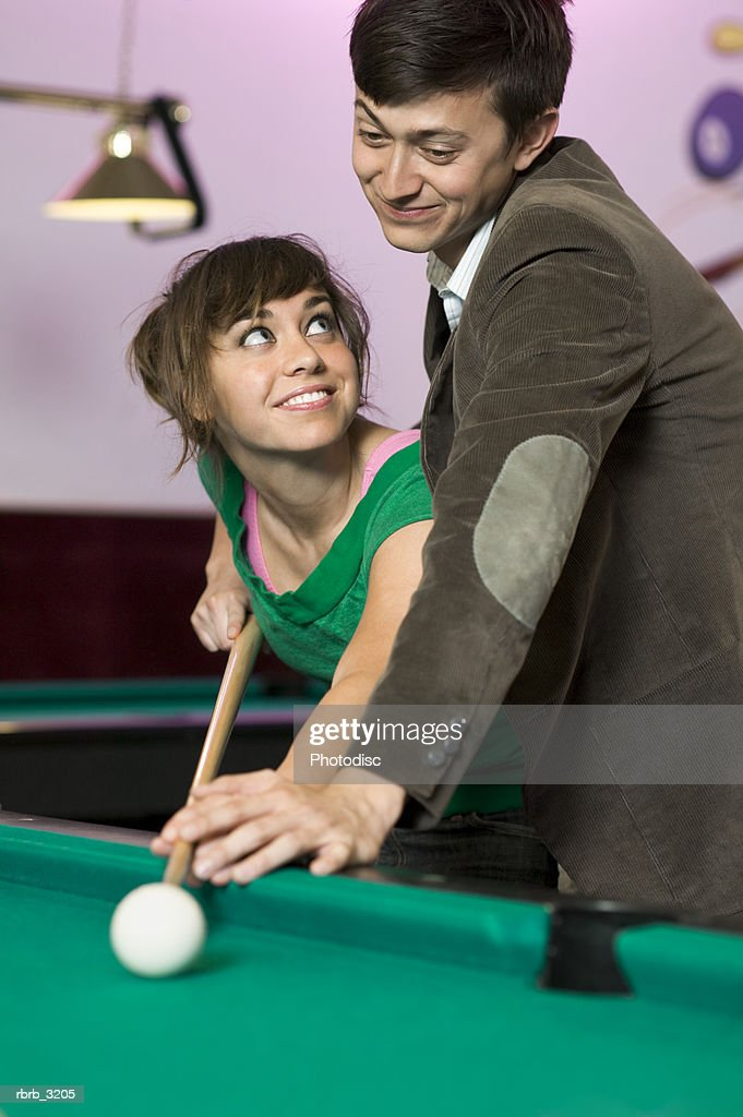 Young couple playing pool : Foto de stock