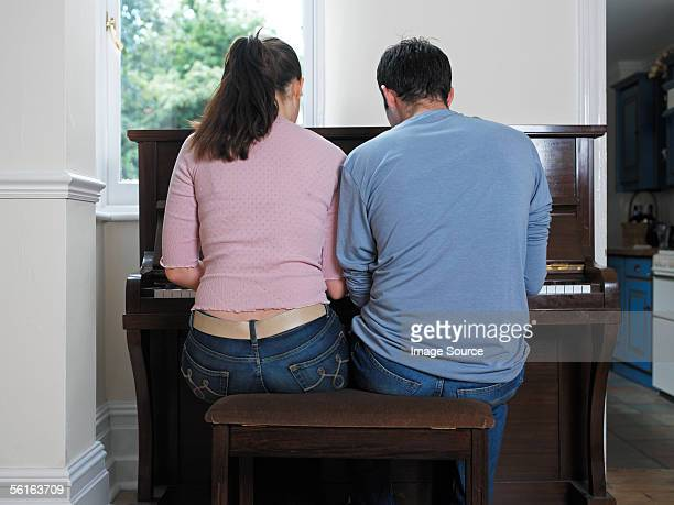 Young couple playing the piano