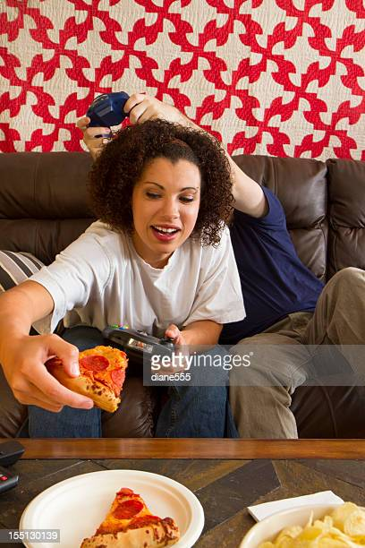Young Couple Playing Video games Together