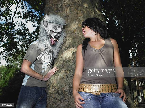 young couple playing with halloween mask - ugly boys photos stock photos and pictures