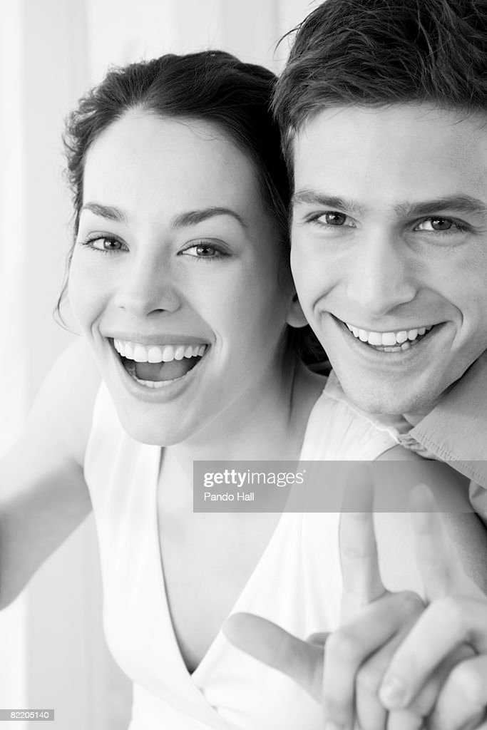 Young couple pointing and laughing : Stock Photo