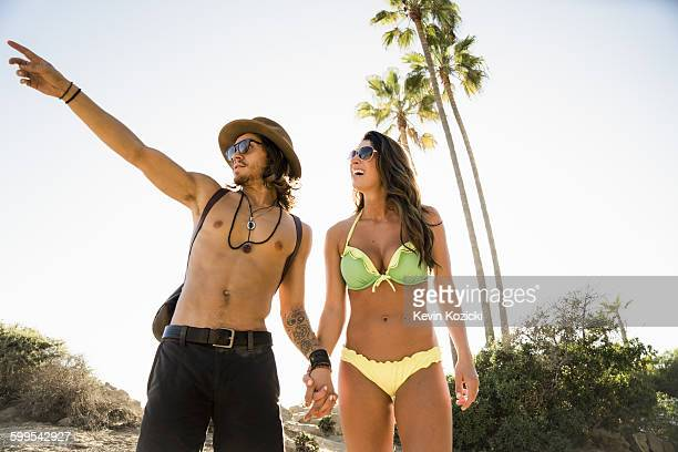 Young couple pointing from Newport Beach, California, USA