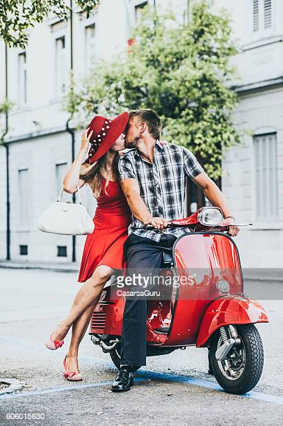 Young Couple Portrait with a Vintage Scooter
