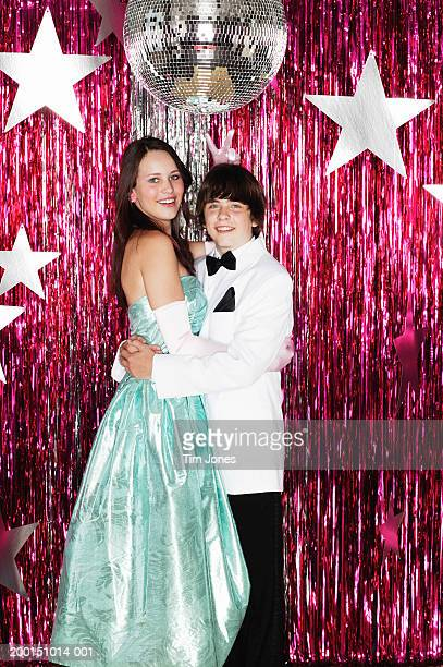 young couple posing for photograph at formal dance, portrait - prom stock pictures, royalty-free photos & images