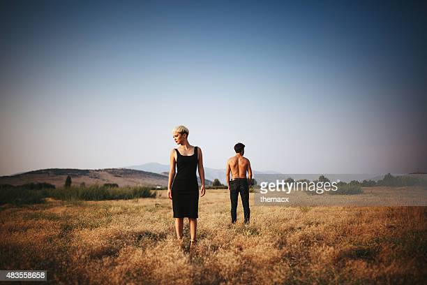 Young couple posing on the field