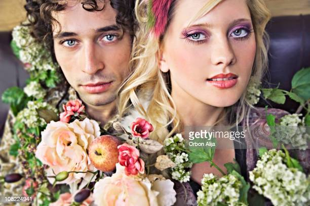 Young Couple Posing with Flowers